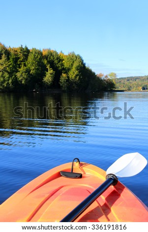 Kayak on the Saint John River in early Autumn season in New Brunswick, The Maritimes in Canada. Focus on front of kayak - stock photo