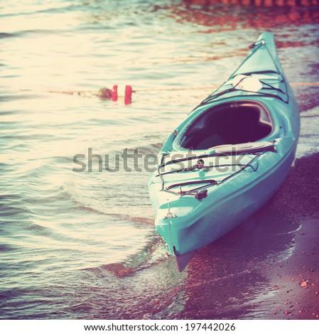 Kayak on the shore - stock photo