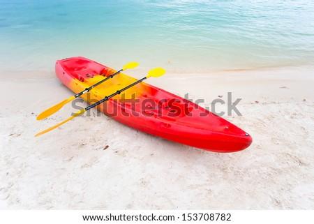 Kayak on the tropical beach - stock photo