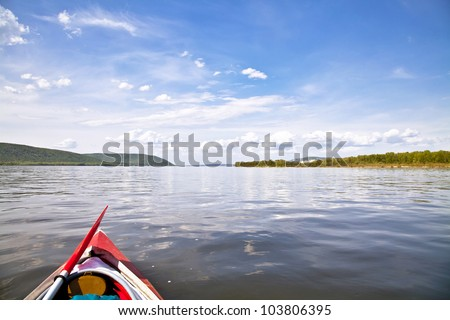 kayak on the water. Against the background of Zhiguli Mountains. The Volga River near Samara.