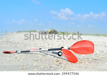 Kayak Paddles on the sand - stock photo