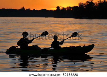 Kayak Silhouette in Sunset - stock photo