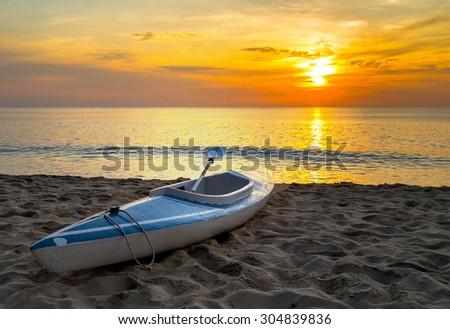 kayak Sunrise on the sand beach sea summer nature landscape coastline - stock photo