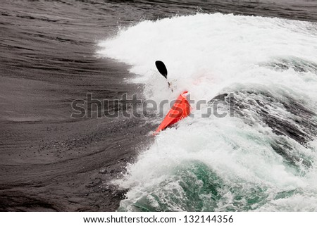 Kayaker capsizing white whitewater kayaking enjoying the extreme thrill of paddling fast currents  breaking waves and wild water