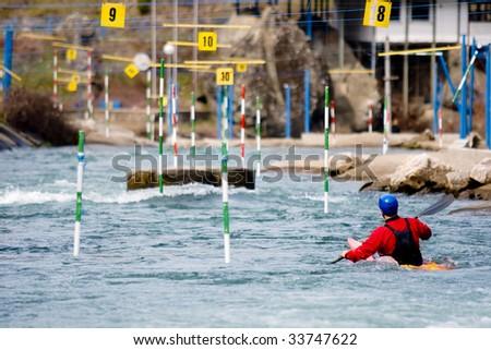 kayaker manoeuvring in white water - stock photo