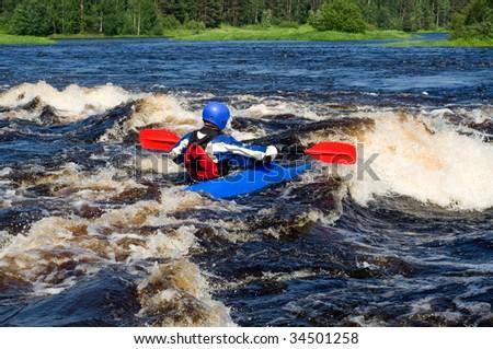 Kayaker sporting a kayak cuts through water - stock photo