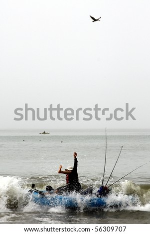 Kayaker unseated by a wave - stock photo
