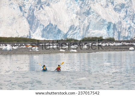 kayakers in front of Aialik glacier, Kenai Fjords National Park (Alaska)  - stock photo
