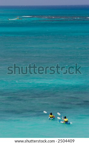 Kayakers on blue caribbean sea - stock photo
