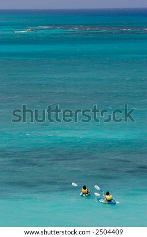 Kayakers on blue caribbean sea - stock photo