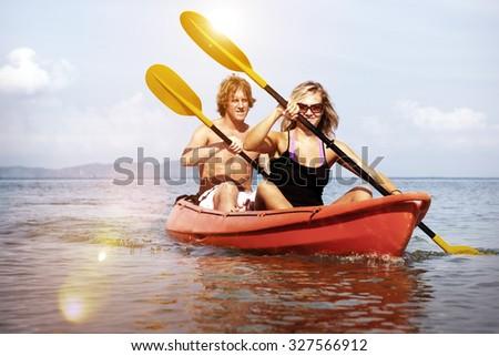 Kayaking Adventure Happiness Recreational Pursuit Couple Concept - stock photo