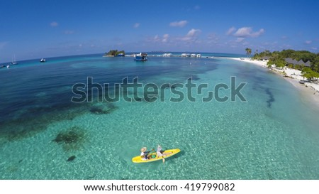 Kayaking during Summer time holiday in Kuredu, Maledives. Canoe fun, view from the top (zenith view) - stock photo