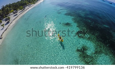 Kayaking during Summer time holiday in Kuredu, Maledives. Canoe fun, view from the top (zenith view)