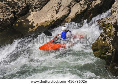Kayaking in white water, blurred motion