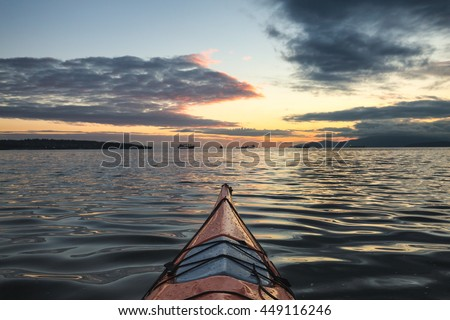 Kayaking near Downtown Vancouver during a beautiful sunset.