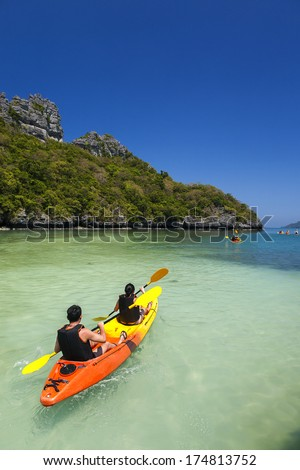 Kayaking on beautiful beach at Ang Thong National Park, Surat Thani, Thailand - stock photo