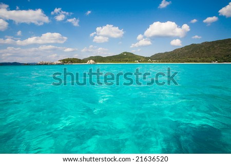 Kayaking on clear blue waters of Okinawa - stock photo