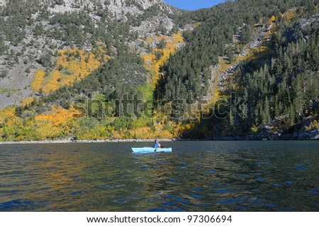 Kayaking on Lake Sabrina in the southern California Sierra Nevada Mountains - stock photo