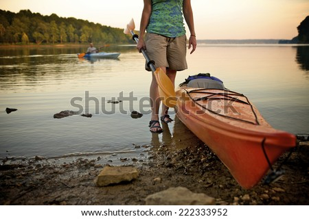 Kayaking with new kayaks at Lake Monroe in Bloomington, IN. Using them for recreation and leisure. - stock photo
