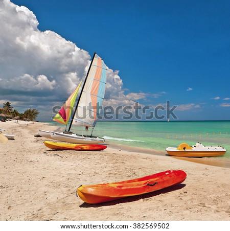 Kayaks and catamarans at the beautiful beach of Varadero in Cuba  - stock photo