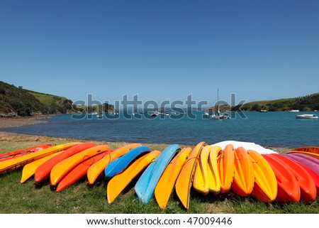 Kayaks at Matiatia Bay, Waiheke Island, Auckland. - stock photo