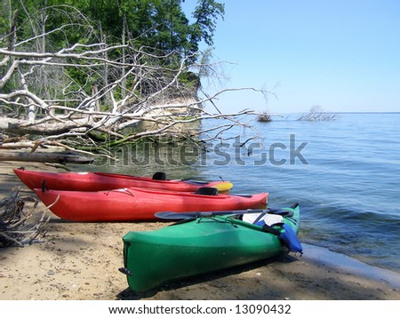 Kayaks beached on Fossil Island, Westmoreland State Park, Virginia. - stock photo