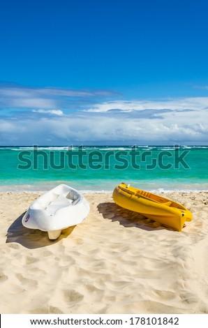 Kayaks on the beautiful sandy Caribbean beach in Dominican Republic - stock photo