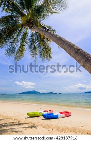 Kayaks on the tropical beach, Payam island, Ranong, Thailand. - stock photo