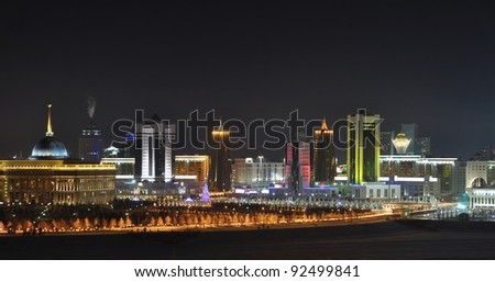 Kazakhstan Astana skyline illuminated - stock photo