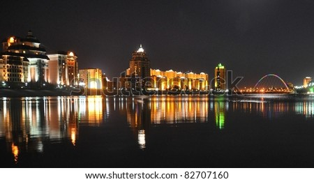 Kazakhstan capital city Astana illuminated at night - stock photo