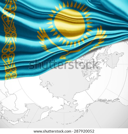 Kazakhstan flag of silk and world map background - stock photo