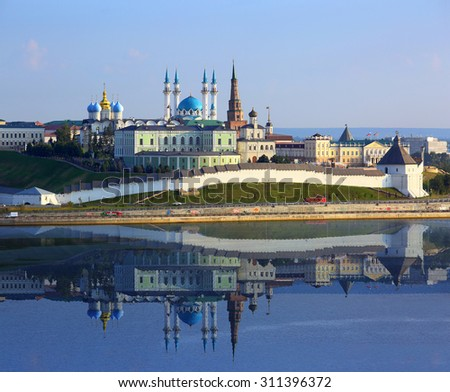 kazan kremlin with reflection in river at sunset - russia