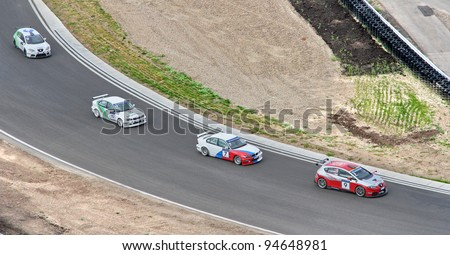 KAZAN, RUSSIA - AUGUST 21: Competitors of the Russian Touring Car Championship (RTCC) take part at the 4th stage of RTCC August 21, 2011 in the Kazan Ring, Kazan, Russia. - stock photo
