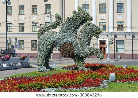 KAZAN, RUSSIA - JULY 25, 2015: Living sculpture of Ak Bars (winged snow leopard), the official symbol of Tatarstan. Ak Bars depicted on the Emblem of Tatarstan, which was approved on February 7, 1992. - stock photo
