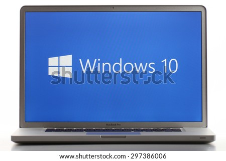 KAZAN, RUSSIA, July 2, 2015: Notebook computer with Windows 10 logo. Windows 10 is the new version of Windows OS by Microsoft Corporation; it starting July 29, 2015. - stock photo