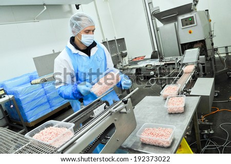 Kazatin, UKRAINE-September 15, 2010: production of minced meat in a butcher shop, September 15, 2010 in a meat factory, Kazatin, Ukraine
