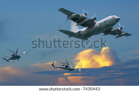 KC-130 tactical tanker with two helicopters - stock photo