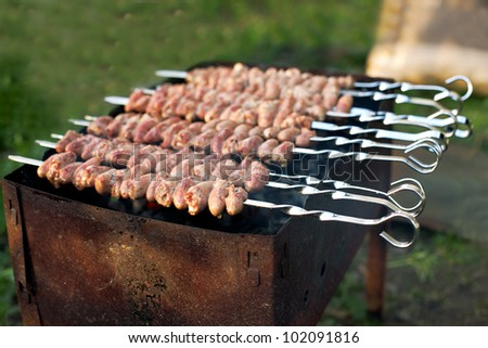 kebab from chicken hearts cooking on skewers