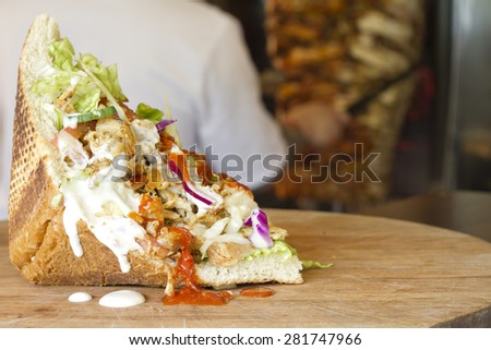 Kebab grilled meat in bread in restaurant - stock photo