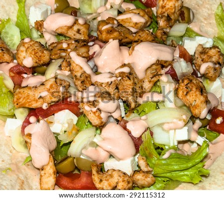 Kebab salad with grilled meat and vegetables topped with sauce, macro close-up, food background - stock photo