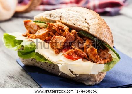 Kebab sandwich on a table - stock photo