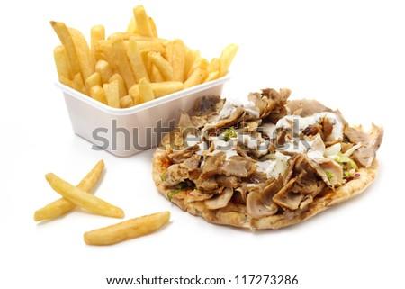 kebab with yogurt sauce and basket of fries on white background - stock photo