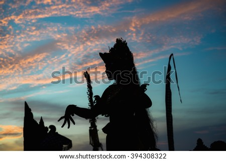 kechak beautiful ritual dance in Bali at sunset in the temple of Uluwatu . Men and women dance kechak in national costumes and authentic costumes.