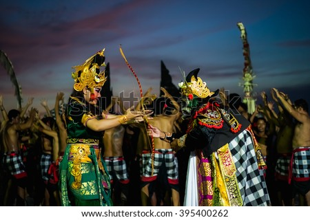 kechak beautiful ritual dance in Bali at sunset in the temple of Uluwatu . Men and women dance kechak in national costumes and authentic costumes.  - stock photo