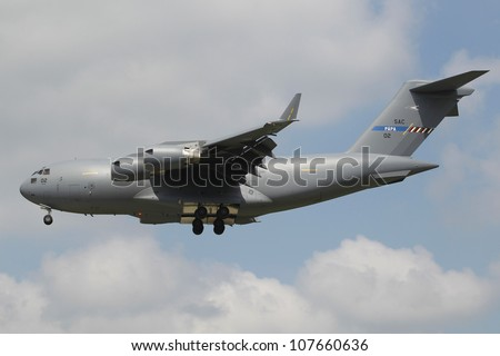 KECSKEMET, HUNGARY - AUGUST 7, a C-17 Globemaster flies at the International Air and Military Show on August 7, 2010 in Kecskemet, Hungary - stock photo