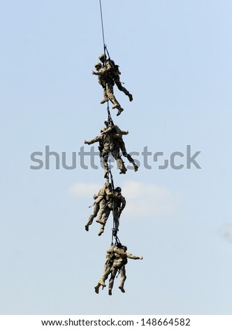KECSKEMET, HUNGARY - AUGUST 3: Hungarian army soldiers performs anti terrorist assault  August 3, 2013 in Kecskemet
