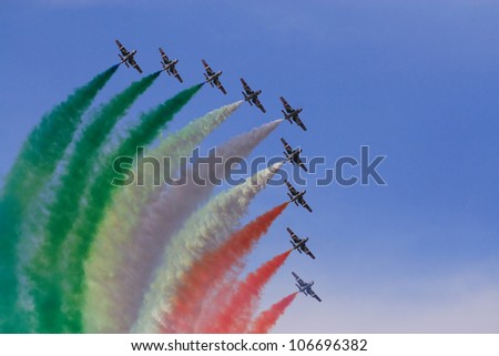 KECSKEMET, HUNGARY - AUGUSTUS 17: the aerobatic display team named Frecce Tricolori flies at the International Air and Military Show on Augustus 17, 2008 in Kecskemet, Hungary