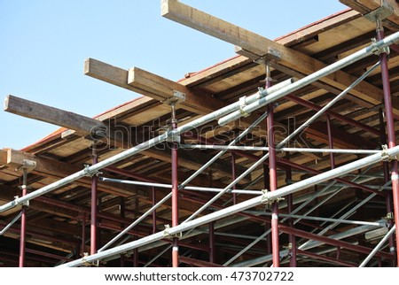 KEDAH, MALAYSIA -AUGUST 05, 2016: Scaffolding used as the temporary structure to support platform, form work and structure at the construction site. Also used it as a walking platform for workers.