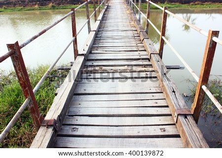 Kedah, Malaysia, March 21, 2016. The bridge is made of wood used by villagers to cross the river to the village opposite.