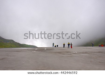 KEDARNATH, UTTARAKHAND, INDIA, MAY 29, 2016: Heavy mist. People waiting for the helicopter to take them to the base.